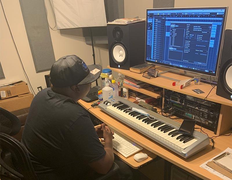 producer Jersey Dougboy at a computer